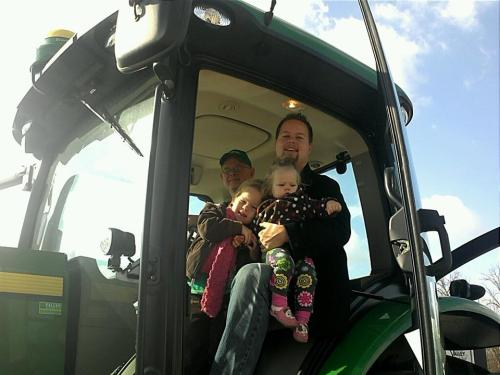 Grandpa gave us all a ride in the big tractor