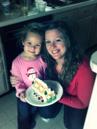 Mommy and Violet had a fun times at a MOPS group making a gingerbread (graham cracker) house.